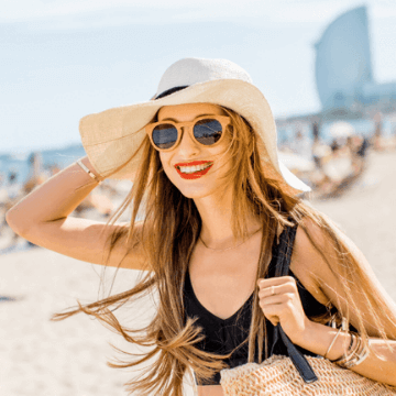 Lady going to the beach in Barcelona