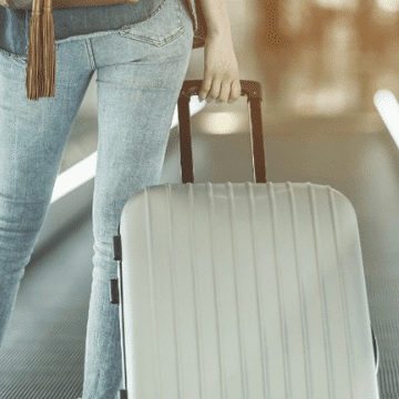 Lady going from El Prat Airport to Barcelona carrying her luggage
