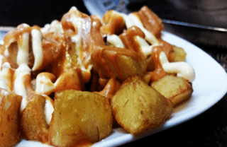 Best tapas in Barcelona: make sure to order Patatas Bravas