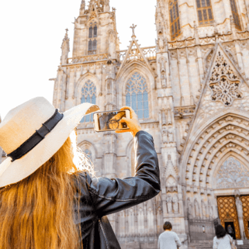 Lady taking a picture of La Seu cathedral