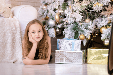 Little girl with presents on Three Kings Day in Spain
