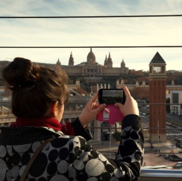 Lady taking a picture in Parc Montjuic