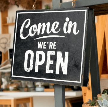 """""""Come in, we are open"""" sign in Spain"""