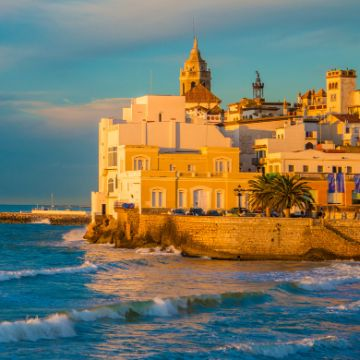 Sitges things to do: view of Old Sitges from Sant Sebastià beach