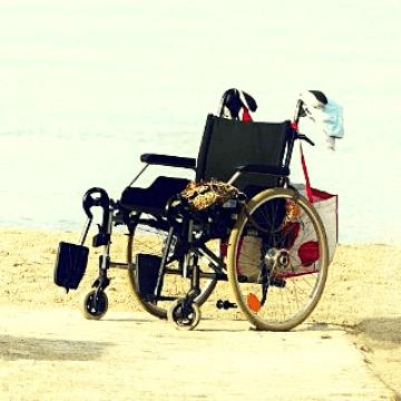 Wheelchair in a Barcelona beach