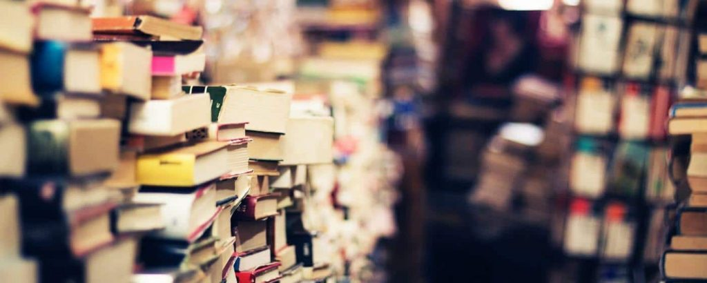 Travel books piled in a store