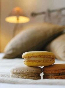 Macaroons in hotel bed