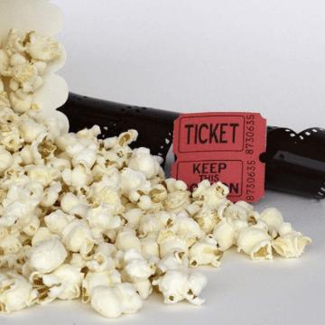Popcorn, movie ticket and film