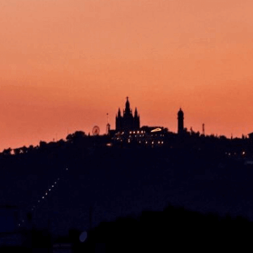 View of Tibidabo Mountain at sunset (Barcelona, Spain)