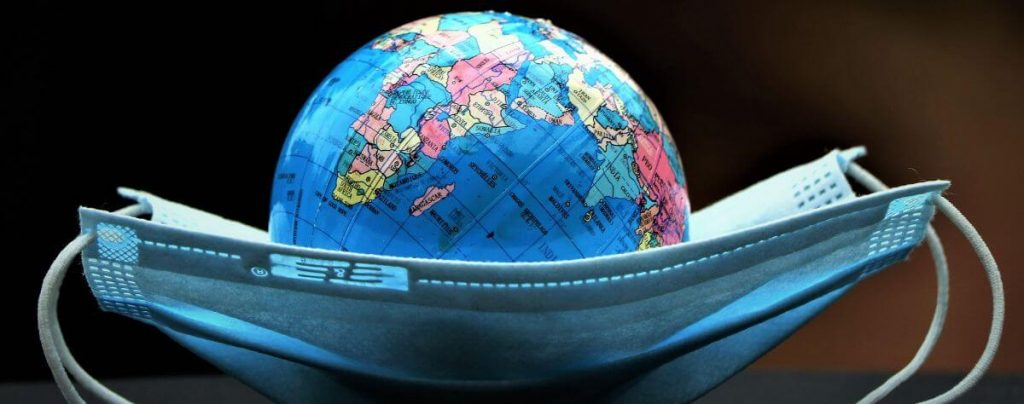 Toy globe and face mask