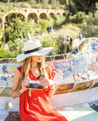 Lady in Park Guell enjoying the best day tours in Barcelona
