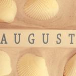 """Word """"August"""" written in a piece of wood in a beach in Barcelona"""